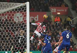 Mame Biram Diouf of Stoke City (C) heads at goal - Mandatory by-line: Jack Phillips/JMP - 17/12/2016 - FOOTBALL - Bet365 Stadium - Stoke-on-Trent, England - Stoke City v Leicester City - Premier League