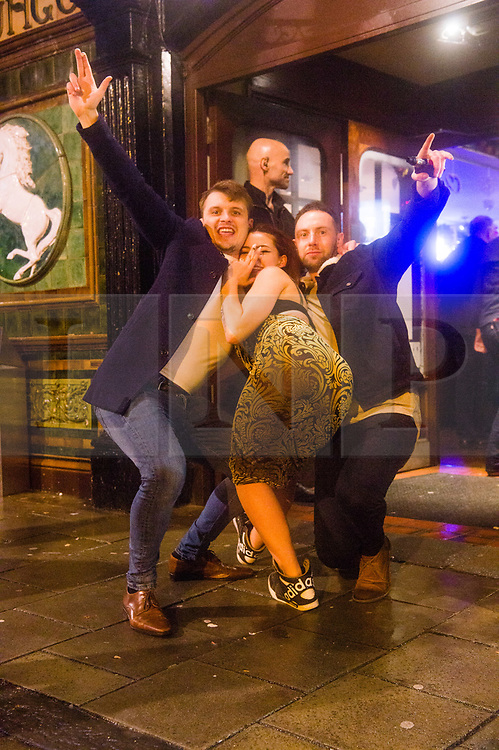 © Licensed to London News Pictures. 21/12/2018. Aberystwyth, UK. People out on the streets of Aberystwyth and enjoying themselves celebrating Mad Friday (or Black Eye Friday or Mad Booze Friday) - the last Friday before Christmas, when , in a recent tradition, workers go out to party celebrate the start of the xmas holidays on the last weekend before the festive break. Photo credit: Keith Morris/LNP