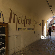 Master's courtyard sign on the wall in Tallinn old town, Estonia