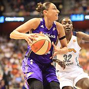 Diana Taurasi, Phoenix Mercury, drives past Kalana Greene, Connecticut Sun, during the Connecticut Sun V Phoenix Mercury, WNBA regular season game at Mohegan Sun Arena, Uncasville, Connecticut, USA. 29th June 2013. Photo Tim Clayton
