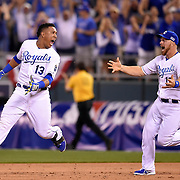 Kansas City Royals catcher Salvador Perez kept running and was chased by Kansas City Royals backup catcher Erik Kratz after Perez made the game-winning hit in the 12th inning during the American League Wild Card playoff baseball game on September 1, 2014 at Kauffman Stadium in Kansas City, MO. The Royals defeated the A's 9-8.