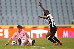 Emmanuel Agyemang Badu of Udinese (R) and  Armin Bacinovic of Palermo during football match between Udinese Calcio and Palermo in 8th Round of Italian Seria A league, on October 24, 2010 at Stadium Friuli, Udine, Italy.  Udinese defeated Palermo 2 - 1. (Photo By Vid Ponikvar / Sportida.com)