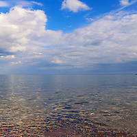 """""""Spirit Glide in Blue""""<br /> <br /> Blue skies with puffy white clouds and calms waters of Lake Superior in Marquette Michigan!"""