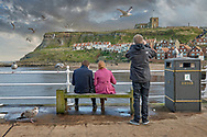 BY THE SEA - WHITBY -  colour photo art by Paul Williams of people attending Whitby Goth weekend