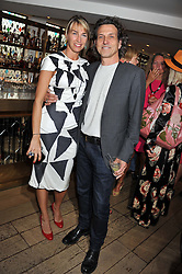 STEPHEN & ASSIA WEBSTER at a party to celebrate the publication on The House of Rumour by Jake Arnott held at The Ivy Club, West Street, London on 9th July 2012.