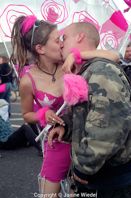Couple kissing in front of police line-up at Protest and Demonstration outside Excel Center Arms Trade Fair in London on 9.11.01.