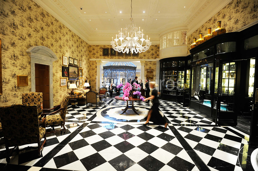 """The Upper Thames Foyer of the Savoy Hotel. The iconic hotel reopened after a three year refit that cost £220 million ($350 million). The Savoy Hotel is a located on the Strand, in central London. Built by impresario Richard D'Oyly Carte the hotel opened on 6 August 1889. It was the first in the Savoy group of hotels and restaurants owned by Carte's family for over a century. It has been called """"London's most famous hotel"""" and remains one of London's most prestigious and opulent hotels, with 268 rooms and panoramic views of London."""