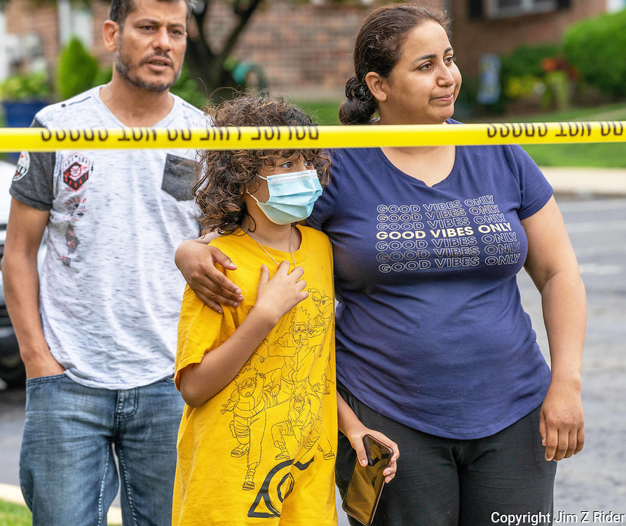 Imane Loffi, (right) 33, of Eagleville, Pennsylvania, her daughter, Amira Elsayed, 9, and husband, Elsayed Elsayed, 46, survey what remains of their home.  It was one of three homes destroyed during an explosion after a resident pulled a gun on a code enforcement officer. The officer was following up on a hoarding complaint at a row home in Eagleville, Pennsylvania, according to Providence Township Police Chief Michael Jackson.  The officer managed to get away safely but as the resident retreated into his home, a series of explosions were heard by neighbors. The remains of the man were found the next day in the rubble of his home. Their 14-year-old daughter was babysitting for the younger children at the time of the blast. They owned the home and their insurance agent was on the scene the next morning.