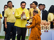 09 JUNE 2016 - BANGKOK, THAILAND: Gen PRAYUT CHAN-O-CHA, the Prime Minister of Thailand, presents alms to Buddhist monks during a special merit making ceremony at the Grand Palace. Thailand marked 70 years of the reign of Bhumibol Adulyadej, the King of Thailand, with a special alms giving ceremony for 770 monks in front of the Grand Palace in Bangkok. The King, also known as Rama IX, ascended the throne on 9 June 1946. He is the longest serving monarch in Thai history and the longest serving monarch in the world today. He is revered by most Thais and is widely seen as a unifying figure in the country.     PHOTO BY JACK KURTZ
