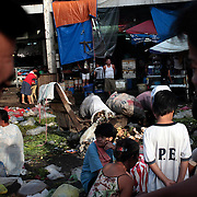 An early morning scene on October 9, 2008 at Divasoria markets, Manila, the Philippines. Photo Tim Clayton