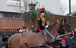 © Licensed to London News Pictures. 06/02/2012. LONDON, UK. A member of the Kings Troop Royal Horse Artillery smiles as she leaves the unit's St John's Wood barracks today for the last time. Gunners of the Kings Troop, based at St John's Wood since 1947, today (06/02/12) left their barracks for the last time to fire their guns in Hyde Park, the soldiers will move tomorrow to their new home in Woolwich. Photo credit: Matt Cetti-Roberts/LNP