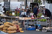 People wearing face masks for protection from Coronavirus / Covid-19 at the weekly market on 25th September 2021 in Audierne, Brittany, France. While many countries are easing their restrictions, face covering and proof of vaccination is very much in effect in Framce.