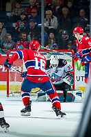 KELOWNA, BC - JANUARY 31: Roman Basran #30 of the Kelowna Rockets makes a save on a shot by Cordel Larson #16 of the Spokane Chiefs during first period at Prospera Place on January 31, 2020 in Kelowna, Canada. (Photo by Marissa Baecker/Shoot the Breeze)