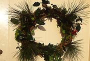 A07WP6 Christmas wreath on cream wooden door