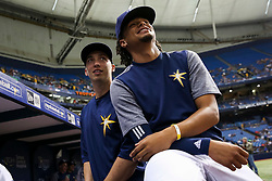 July 21, 2017 - St. Petersburg, Florida, U.S. - WILL VRAGOVIC   |   Times.Tampa Bay Rays starting pitcher Blake Snell (4), left, and starting pitcher Chris Archer (22) watch highlights on the scoreboard before the start of the game between the Texas Rangers and the Tampa Bay Rays at Tropicana Field in St. Petersburg, Fla. on Friday, July 21, 2017. (Credit Image: © Will Vragovic/Tampa Bay Times via ZUMA Wire)