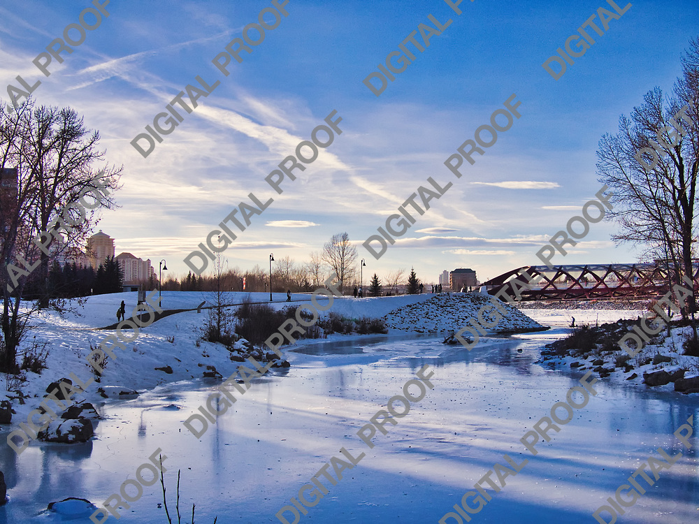 Calgary, Alberta, Canada - January 5, 2013 Snowy landscape of Peace Bridge over a frozen Bow River during a winter afternoon