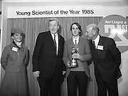 11/01/1985.01/11/1985.11th January 1985.The Aer Lingus Young Scientist Exhibition at the RDS Dublin ..Ronan McNulty of Rathfarhnam, Dublin, the Aer Lingus Young Scientist of the Year 1985 with his trophy. Also pictured (L-R) is an Aer Lingus Hostess, Garrett Fitzgerald, Taoiseach and Michael Dargan, Chairman of Aer Lingus.