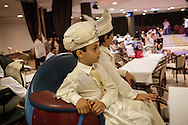 Dressed as miniture Ottoman Sultans, the boys ride around a room in the Circumcision Palace in Istanbul, Turkey. After entertainment and games the operation is performed on stage.