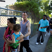 Cesar Dickensauge, 32, brought his girlfriend, Lucero Valera and daughter, Alicia Valera, 2, to the Second Chance Ministry food giveaway in San Bernardino, CA. They received two bags of food.
