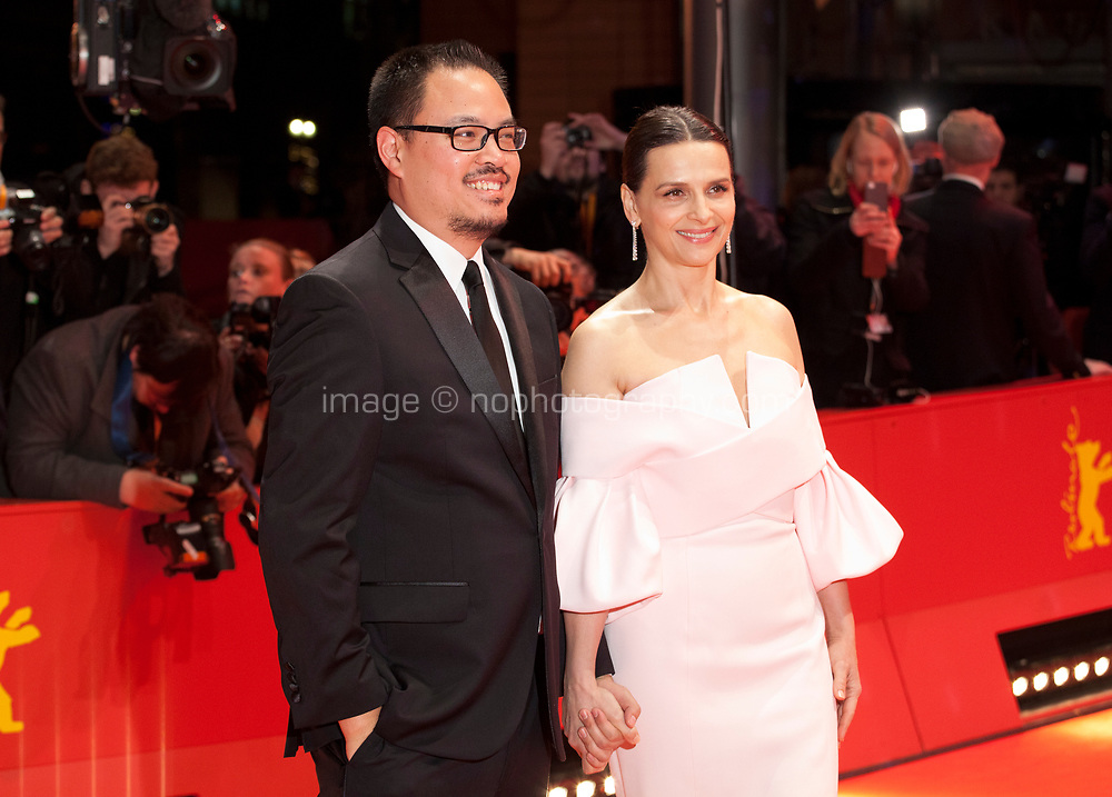 Justin Chang and  Juliette Binoche, Jury President at the Award Ceremony red carpet at the 69th Berlinale International Film Festival, on Saturday 16th February 2019, Berlinale Palast, Berlin, Germany.
