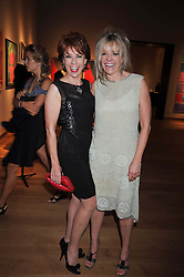 Left to right, KATHY LETTE and JO WOOD at fundraising dinner and auction in aid of Liver Good Life a charity for people with Hepatitis held at Christies, King Street, London on 16th September 2009.