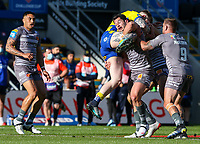 Warrington Wolves' Josh Charnley is tackled by Catalans Dragons' Benjamin Garcia<br /> <br /> Photographer Alex Dodd/CameraSport<br /> <br /> Rugby League - Betfred Challenge Cup Quarter Finals - Catalans Dragons v Warrington Wolves - Friday 7th May 2021 - Emerald Headingley Stadium - Leeds<br /> <br /> World Copyright © 2021 CameraSport. All rights reserved. 43 Linden Ave. Countesthorpe. Leicester. England. LE8 5PG - Tel: +44 (0 116 277 4147 - admin@camerasport.com - www.camerasport.com