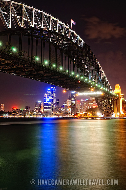 Night shot of Sydney Harbour Bridge and skyline of Sydney city looking back towards Dawes Point and taken from Milsons Point.