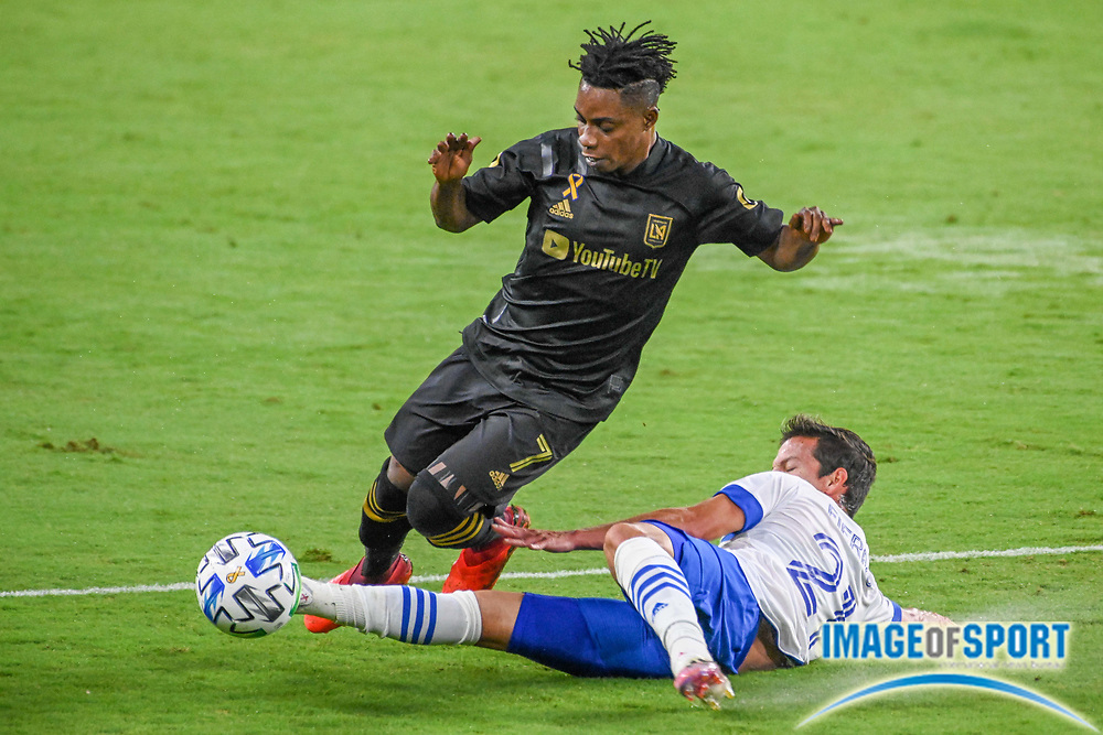 LAFC forward Latif Blessing (7) leaps over San Jose Earthquakes midfielder Carlos Fierro (21) during a MLS soccer game, Sunday, Sept. 27, 2020, in Los Angeles. The San Jose Earthquakes defeated LAFC 2-1.(Dylan Stewart/Image of Sport)