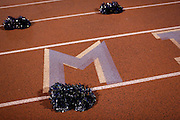 Cheerleader pom-pons sit on the track during a game between Milpitas High School and Woodside at Milpitas High School in Milpitas, California, on September 13, 2013. The Trojans went on to beat the Wildcats 50-6. (Stan Olszewski/SOSKIphoto)