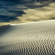The texture of the dunes is brought out by the low level of the sun at sunset, White Sands National Monument, New Mexico