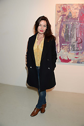 Actress MAIMIE McCOY at a private view of an exhibition of paintings by Billy Zane entitled 'Save The Day Bed' held at the Rook & Raven Gallery, Rathbone Place, London on 10th October 2013.