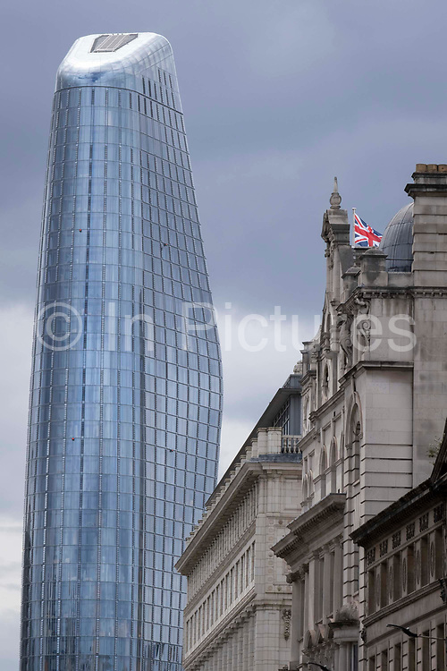 Seen from the City of London, One Blackfriars one of the capitals newest skyscrapers rises above a Union jack flag, on 22nd June 2021, in London, England. Located on Bankside, the south bank of the river Thames, the development is a 52-storey 170m tower whose uses include residential flats, a hotel and retail.