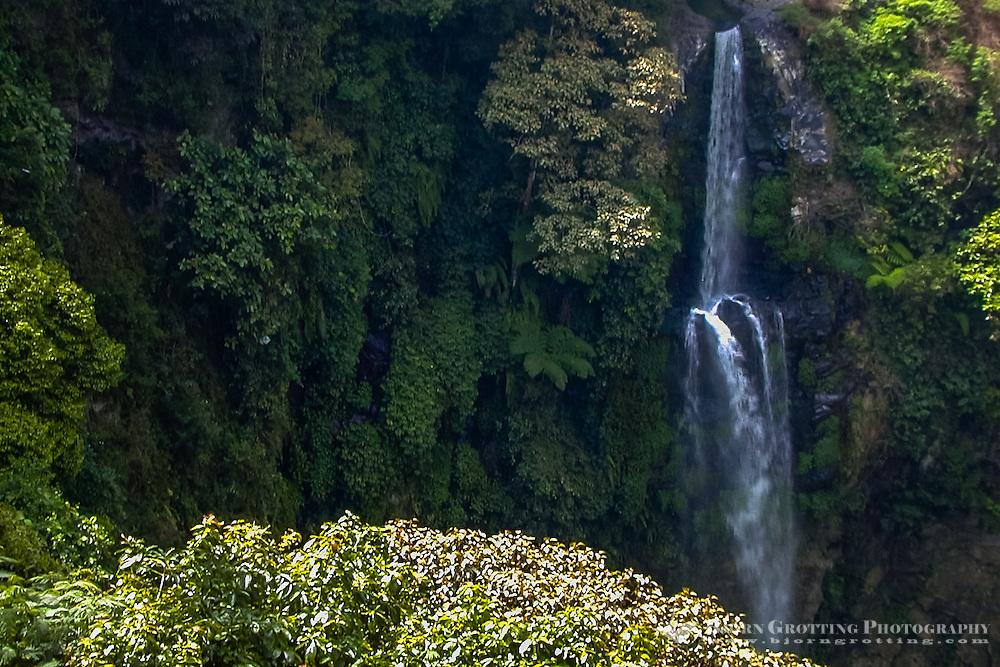 Indonesia, Java, Bandung. The Air Terjun Cerug Pengantin waterfall a few kilometers north of Bandung falls into a narrow valley.