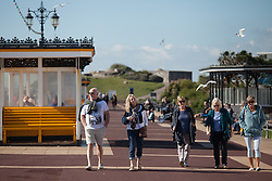© Licensed to London News Pictures. 02/10/2016. Southsea, Hampshire, UK.  People walking along Southsea Promenade and enjoying the warm, sunny weather on another stunning autumn day. Photo credit: Rob Arnold/LNP