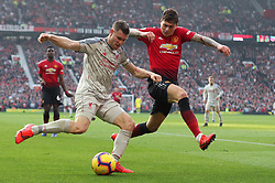 Liverpool's James Milner (left) and Manchester United's Victor Lindelof battle for the ball