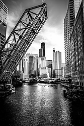 Chicago Kinzie Street Bridge Black and White Picture with  Chicago River, Willis Tower (Sears Tower) and other downtown Chicago buildings. Kinzie Street Railroad Bridge is a Chicago landmark that is permanently raised and no longer used. Photo Copyright © 2012 Paul Velgos with All Rights Reserved.