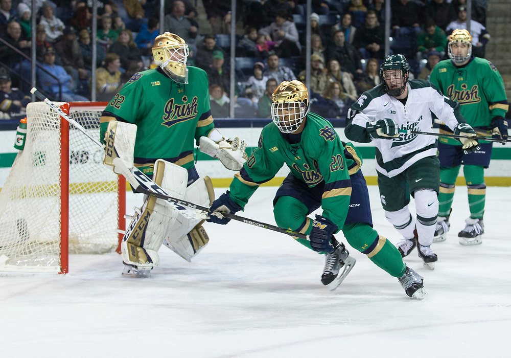 February 24, 2018:  Notre Dame defenseman Justin Wade (20) skates for the puck during NCAA Hockey game action between the Notre Dame Fighting Irish and the Michigan State Spartans at Compton Family Ice Arena in South Bend, Indiana.  John Mersits/CSM