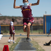 Briley Dauphinais of Tohatchi competes in the long jump Friday in Zuni.