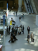 people walking in the lobby of large conference hall Japan