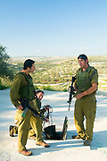 Israel, West Bank, Israeli reserve soldiers on foot patrol during active duty searching a water hole for hidden explosives and weapons