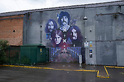 Black Sabbath street art mural in Digbeth in Birmingham city centre, which is virtually deserted under Coronavirus lockdown on a wet rainy afternoon on 28th April 2020 in Birmingham, England, United Kingdom. Britains second city has been in a state of redevelopment for some years now, but with many outdated architectural remnants still remaining, on a grey day, the urban landscape appears as if frozen in time. Coronavirus or Covid-19 is a new respiratory illness that has not previously been seen in humans. While much or Europe has been placed into lockdown, the UK government has put in place more stringent rules as part of their long term strategy, and in particular social distancing.