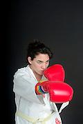 Aggressive female boxer On black Background
