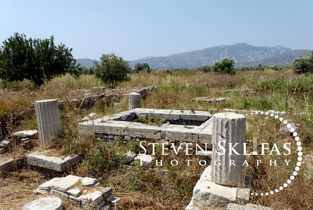 Iraion. Samos. Greece. View of the remains of a 5th century BC running well that was decorated with columns and a shelter. Heraion is the main sanctuary of ancient Samos and is located on the southeast coast, 6 km kilometres from Pythagoreio.
