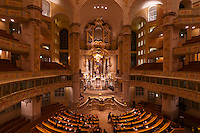 A choir performs a concert inside the Frauenkirche (church), Dresden, Saxony, Germany