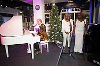 John Galea performing  festive songs at the Yamaha Store in Soho, London.