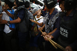August 15, 2017 - Kathmandu, Nepal - An activist shout slogans to riot police during a demonstration to save the life of Dr. Govinda KC who is in hunger strike for the last 23 days for the 11th time demanding reforms in medical education sector in Kathmandu. (Credit Image: © Skanda Gautam via ZUMA Wire)