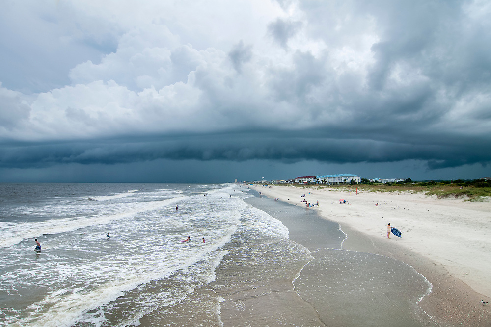 Storm clouds linger over the beach in Ocean Isle Beach, North Carolina on Friday, August 6, 2021. Copyright 2021 Jason Barnette