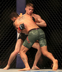 Nathaniel Wood (back) and Jose Quinonez in action during their Bantamweight bout during UFC Fight Night 147 at The O2 Arena, London.