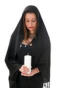 Religious Faith woman lights a candle