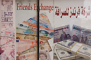 An arabic currency exchange poster in English and Arabic, in the city of Luxor, Nile Valley, Egypt.